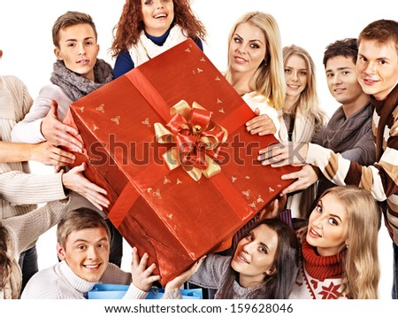 Group people holding red big gift box. Isolated.