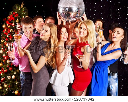 Group people with  champagne dancing at Christmas party.