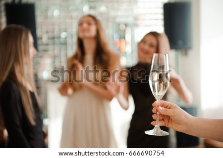 Group people with champagne dancing at the party. #666690754