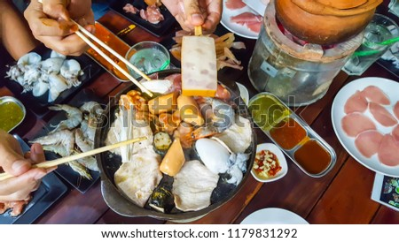 group people with hand in Thai Barbecue Buffet #1179831292