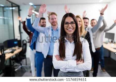 Group picture of business team posing in office