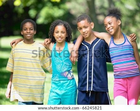 Group portrait of teenagers smiling
