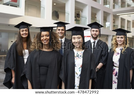 Group portrait of university graduates in cap and gown stock photo