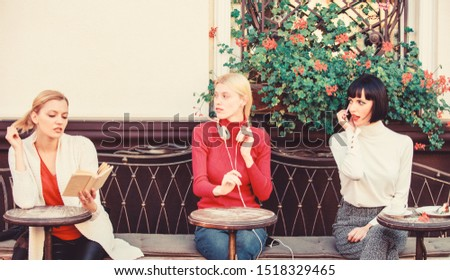 Group pretty women cafe terrace entertain themselves with reading speaking and listening. Information source. Female leisure. Hobby and leisure. Different interests. Weekend relax and leisure. #1518329465