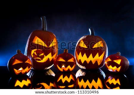 Group pumpkins for Halloween on a blue background