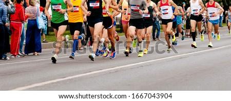 group runners athletes run marathon on city street Stock fotó ©