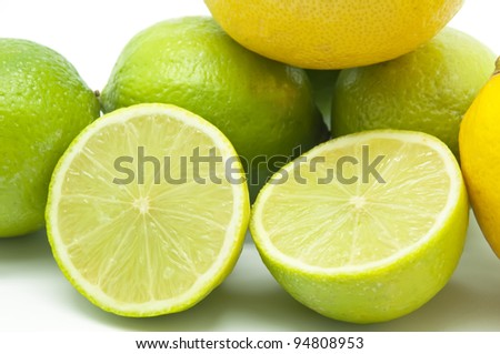 Group several lemons and limes on white background