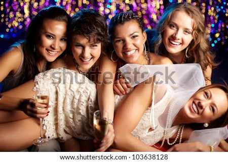 Group shot of young women celebrating their friend�s forthcoming marriage, hen party