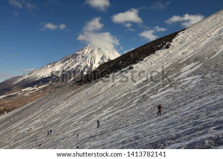 Group skitourer Kamchatka, moving in front of active volcanoes of the peninsula. Ascent of Avacha Volcano #1413782141