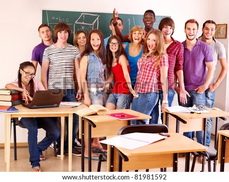 Group student in classroom near blackboard.