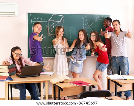 Group student in classroom near blackboard.