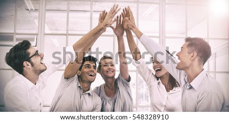 Shutterstock Group therapy in session sitting in a circle high fiving in a bright room