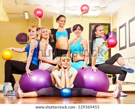 Group women in aerobics class.