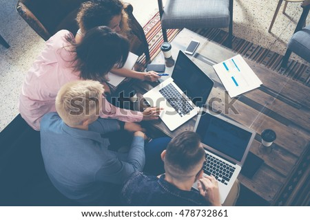 Group Young Coworkers Making Great Business Decisions.Creative Team Discussion Corporate Work Concept Modern Office.New Startup Marketing Idea Presentation.Woman Touching Digital Laptop.Top View