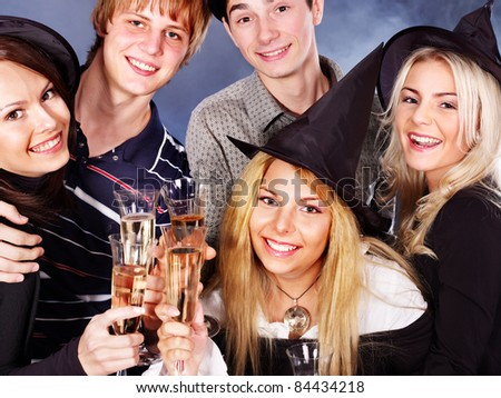 Group young people at nightclub drinking  champagne.