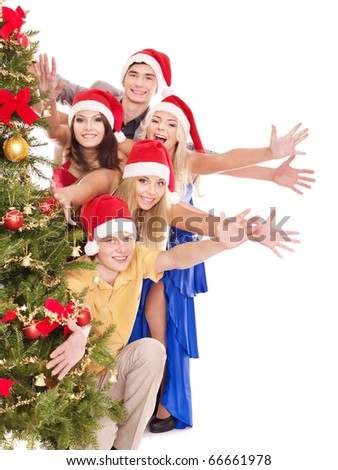 Group young people holding stack gift box by christmas tree.