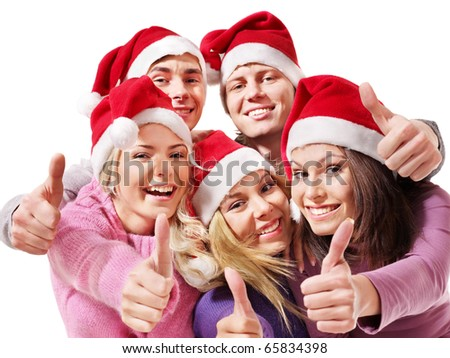 Group young people in santa hat show thumbs up. Isolated.