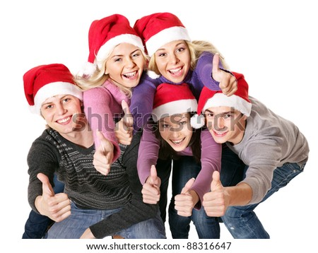Group young people in santa hat showing thumb up. Isolated.