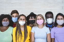 Group young people wearing face mask for preventing corona virus outbreak - Millennial friends with different race and culture portrait -  Coronavirus disease and youth multi ethnic concept