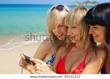 Group young woman model activity on the beach with photo