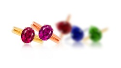 grouping of color gemstone rings  selected focus on white background