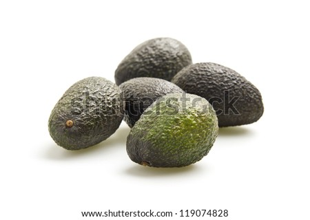 Grouping of fresh avocados photographed on a white background.