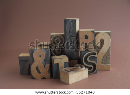 grouping of letterpress wood letters, numbers and symbols