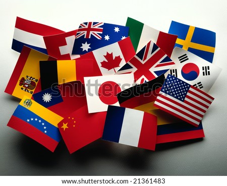 Grouping of various flags of the world on white