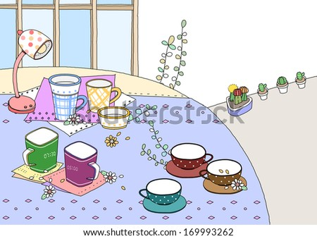 Groupings of dishes on a table by a lamp.