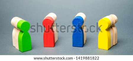 Groups of multicolored wooden people. The concept of market segmentation. Customer relationship management. Target audience, customer care. Groups of buyers. Targeting. Segments