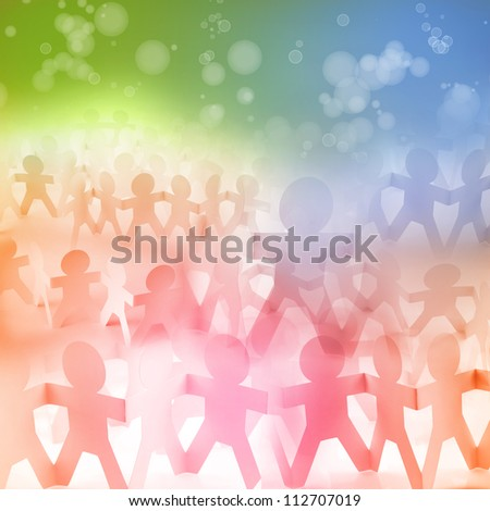 Groups of paper doll people holding hands