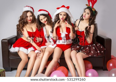 groups of sexy beautiful asian japanese models young lady Pin Up girls wearing winter Christmas costume and red lingerie in Xmas decoration look pose in studio, seductive sensuality provocative desire