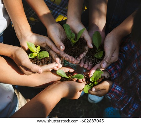 Growing concept. Group children planting together. #602687045
