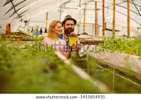 growing flower. growing flower concept. happy couple growing flower. professional gardeners growing flower #1415814935