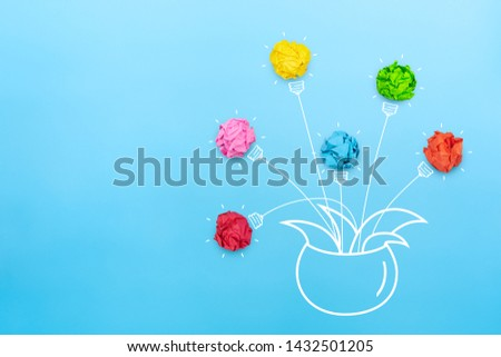 Growing idea, Creative idea, innovation and solution concept with colorful crumpled paper light bulb