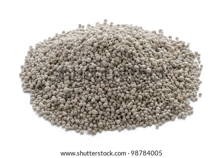 growmore fertiliser in a heap on a white background