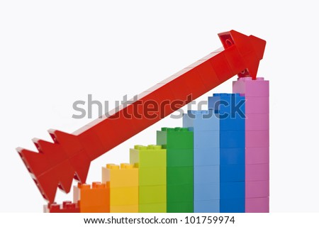 Growth chart from color toy blocks with red arrow - stock photo