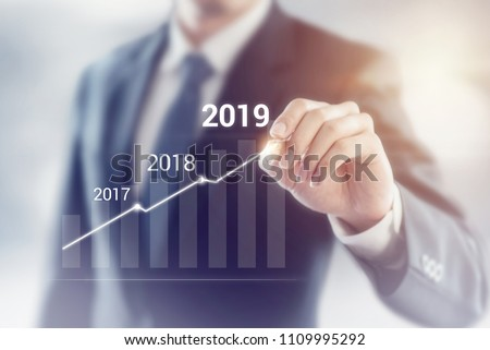 Growth in 2019 year concept. Businessman plan and increase of positive indicators in his business. #1109995292