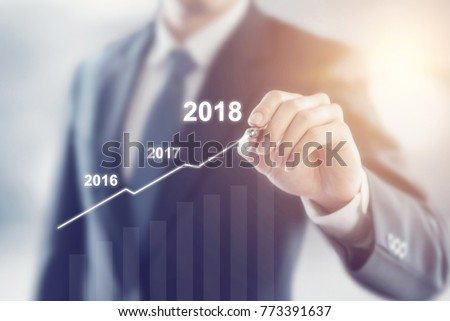 Growth in 2018 year concept. Businessman plan growth and increase of positive indicators in his business.