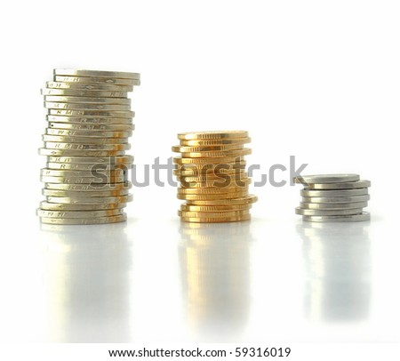 Growth money rising coins isolated on white background