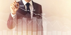Growth success developments in 2020 concept. Businessman forecast analysis plan profit chart with pen and increase of positive indicators. graph business financial plan year 2018, 2019 to 2020.