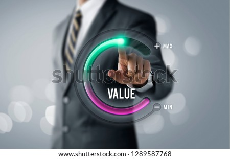 Growth value, increase value, value added or business growth concept. Businessman is pulling up circle progress bar with the word VALUE on bright tone background. #1289587768