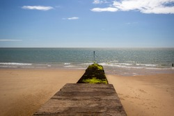Groynes on the beach at high tide. Walton on the Naze, Essex, United Kingdom