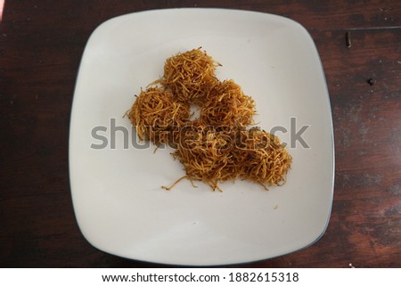 Grubi, a traditional snack made from shaved sweet potatoes, topped with brown sugar, rounded and fried. Zdjęcia stock ©