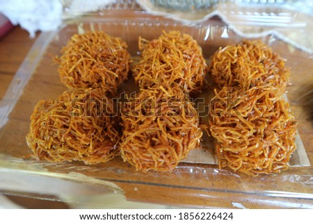 Grubi.  Made from sweet potato, grated and fried, then mixed with brown sugar and formed round. Zdjęcia stock ©