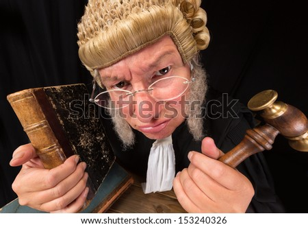 Grumpy old judge in extreme wide angle closeup with hammer and wig Foto d'archivio ©