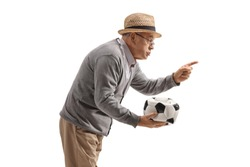 Grumpy old man holding a deflated football and scolding someone isolated on white background