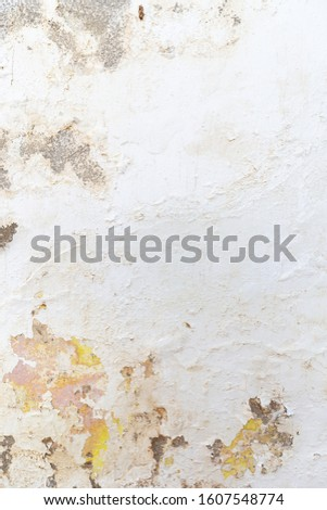 Grunge abstract background. Plaster and paint clog, structural damage, water damage on building wall