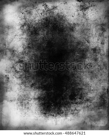 Grunge abstract scratched background, scary wallpaper with central area for your text or picture