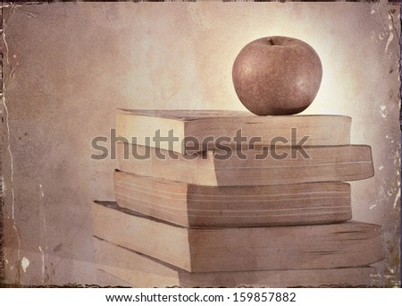 Grunge Apple on a pile of Books